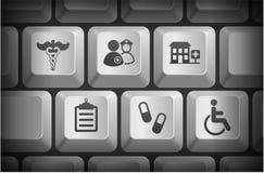 Icônes d'hôpital sur des boutons de clavier d'ordinateur Photo stock
