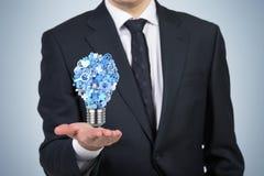 Icônes dans l'ampoule de forme Images stock
