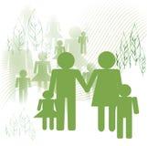 Icônes de famille dans l'environnement vert Photographie stock libre de droits