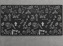 Icônes de flèche sur le tableau noir Photos stock