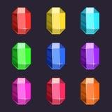 Icônes de gemmes de bande dessinée réglées dans différentes couleurs Photo libre de droits