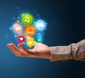 Icônes de multimédia dans la main d'un homme d'affaires Photo libre de droits
