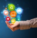 Icônes de multimédia dans la main d'un homme d'affaires Photos stock