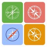 Icônes de vecteur dépeignant quatre boussoles différentes Photos stock