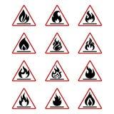 Icônes du feu de danger avec la flamme d'isolement sur le blanc Photo stock