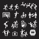 Icônes du football sur le fond noir Photos stock