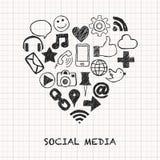 Icônes sociales de media dans la forme de coeur Photos stock