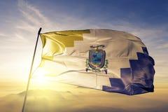 Ica Region of Peru flag textile cloth fabric waving on the top sunrise mist fog. Beautiful stock photos