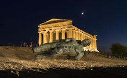 Icarus statue. Night scene: Icarus statue in front of Concordia Temple  at Agrigento Valley of the Temples, Sicily, Italy Royalty Free Stock Images