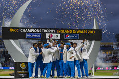 ICC Champions Trophy Final England v India. EDGBASTON, ENGLAND - June 23 2013: India celebrate with the trophy after winning the ICC Champions Trophy final royalty free stock photo