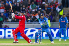 ICC Champions Trophy Final England v India. EDGBASTON, ENGLAND - June 23 2013: James Tredwell and Mahendra Singh Dhoni during the ICC Champions Trophy final stock photos