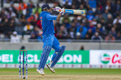 ICC Champions Trophy Final England v India. EDGBASTON, ENGLAND - June 23 2013: India's Mahendra Singh Dhoni hits the ball and is dismissed off the bowling of stock image