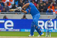 ICC Champions Trophy Final England v India. EDGBASTON, ENGLAND - June 23 2013: India's Rohit Sharma is bowled out by Stuart Broad (not pictured) during the ICC royalty free stock photo