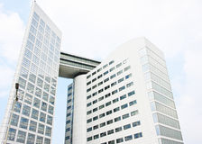 ICC International Criminal Court, The Hague. Large view of the building of the International Criminal Court with judges the dictators and criminal around the Stock Photo