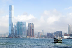 ICC Tower and ferry in Hong Kong Stock Photos