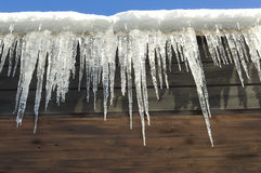 Icicles hanging from roof Royalty Free Stock Photos