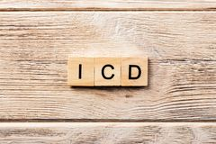 Icd word written on wood block. icd text on table, concept royalty free stock photo