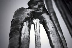Ice. A large icicle that divided into four smaller icicles Stock Photo