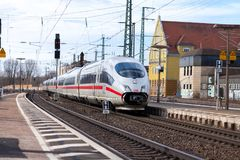Free ICE 3, Intercity-Express Train From Deutsche Bahn Passes Train Station Royalty Free Stock Photo - 111885305
