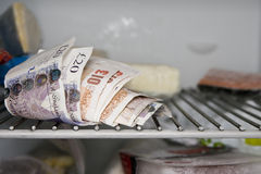 On ice. Cash hidden in the freezer Royalty Free Stock Images