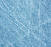Ice. Scratched blue ice surface with tracks Royalty Free Stock Image