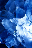 Ice against blue background vertical Stock Image