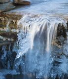 Waterfall stull running covered in ice Stock Photography