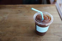 Iced Americano coffee. On wooden table royalty free stock images