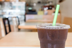 Ice of americano with coffee cafe shop blur background, black co Stock Photography