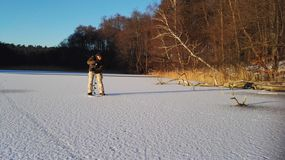 Ice Angler. Drilling a Hole stock images