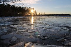 Ice art in Luleå. The sun glistens on the ice floes that November nights storm pushed toward the beach The sun glistens on the ice floes that November Stock Photography