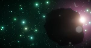 Ice asteroid eclipsing star as it travels through the cold expanse of space on a backdrop of green stars. Perfect for anything related to space and science Stock Image