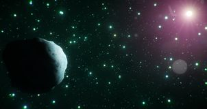 Ice asteroid travels through the cold expanse of space on a backdrop of green stars. Perfect for anything related to space and science. Could also be used for Royalty Free Stock Image
