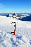 Ice ax in the snow Royalty Free Stock Image