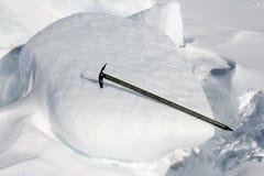 Ice axe. Stuck in an iceberg Stock Photo