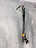 Ice axe. Ice axe in the ice Stock Image