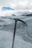 Ice axe fixed on frozen ice. Piolet fixed on ice in the Perito Moreno Glacier, in Argentinian Patagonia Stock Photography
