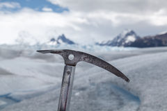 Ice axe fixed in Perito Moreno Glacier. Ice axe fixed in snow with a glacier landscape background Royalty Free Stock Images
