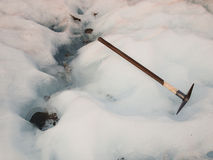 Ice axe on a glacier Royalty Free Stock Photo