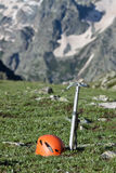 Ice-axe and helmet. Stock Image