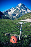 Ice-axe and helmet. Royalty Free Stock Photos