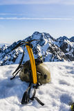 Ice axe, helmet and glasses glacier in the mountains. Royalty Free Stock Photography