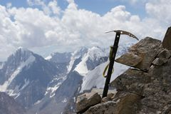 Ice axe in rock over glacier Dugoba, Pamir-alay Stock Image