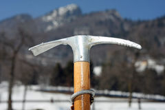Ice axe to climbing with sturdy wood handle Stock Images