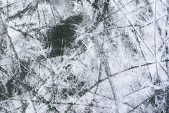 Ice background. Ice with snow, and lots of cracks, hockey background Stock Photos
