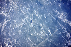 Ice background. Abstract closeup of ice skating marks on outdoor rink Stock Images