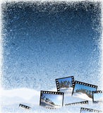 Ice background with film frames. The beautiful winter frozen background with film frames and a snow Royalty Free Stock Photo