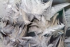 Ice background, frost paint on window. Frost draws abstract ice background patterns on a windowpane. Russia Royalty Free Stock Images