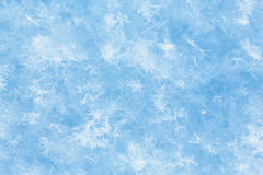 Ice background. Glistening ice crystals lie on the background of the snow surface Stock Photo