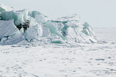 Ice background of huge blocks of aqua ice from fractured floes. Winter backdrop Royalty Free Stock Photos